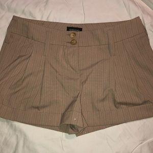 Pre-own BEBE dress shorts size 8.